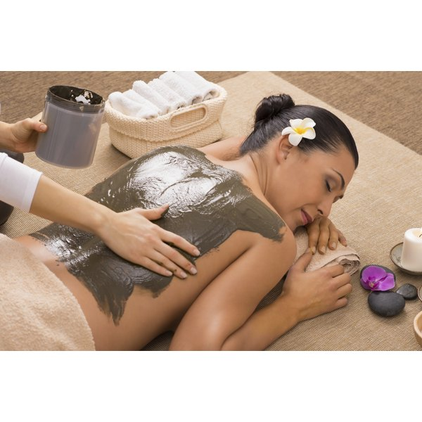 A woman is receiving a spa treatment.