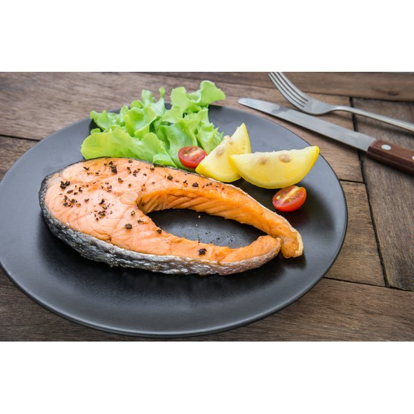 A grilled salmon steak on a plate.