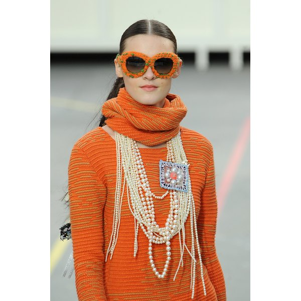 A Chanel model piles on the pearls at Paris Fashion Week Womenswear in March 2014.