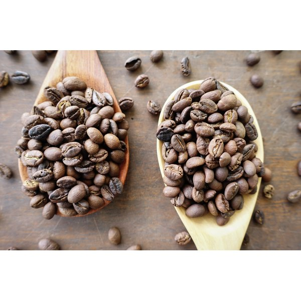 Wooden spoonfuls of roasted coffee beans.