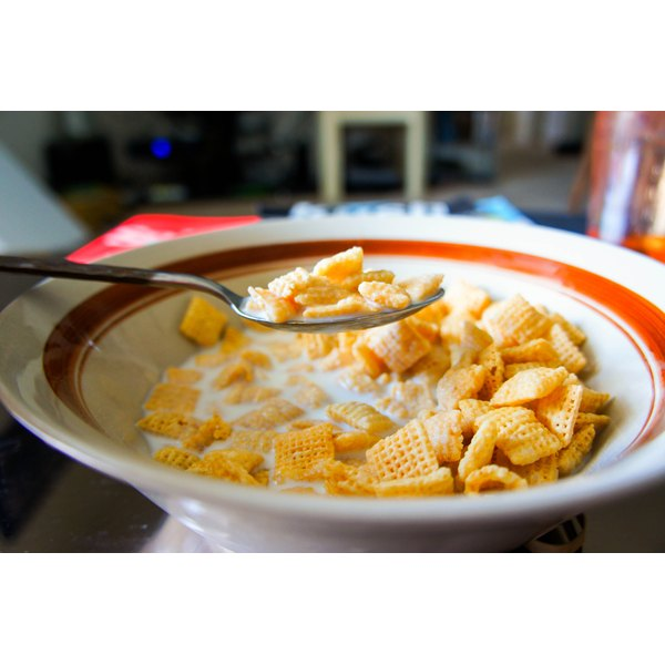 A bowl of Rice Chex cereal and milk.