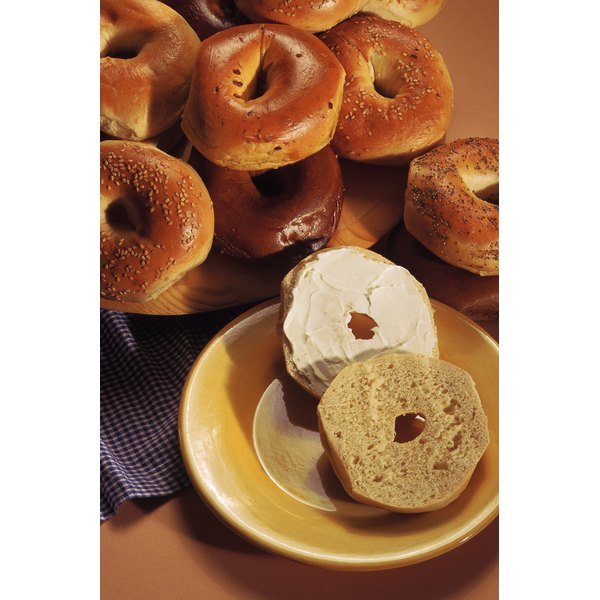 Bagels are popular as breakfast foods, and are high in carbohydrates.