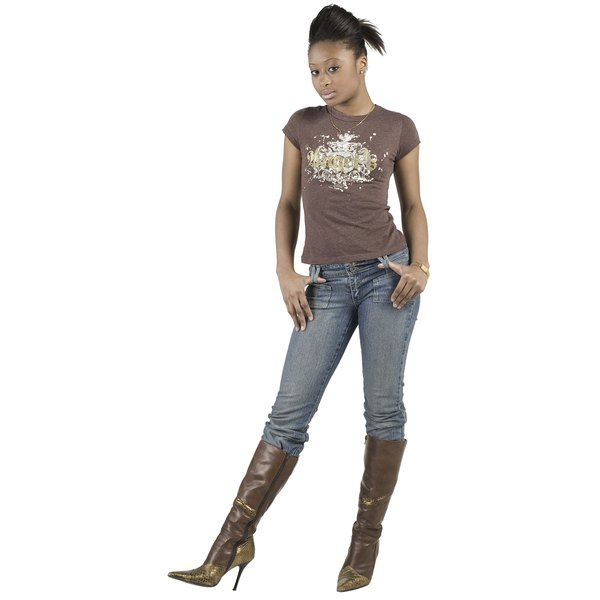 Wearing your jeans while hanging out helps soften the fibers.