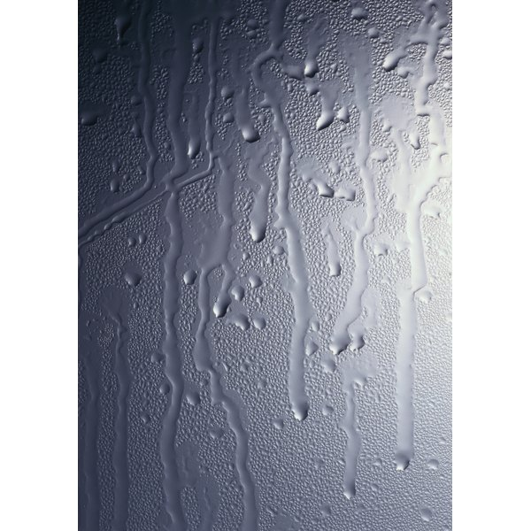 Your once beautiful glass shower door can become an ugly mess due to wear and tear.