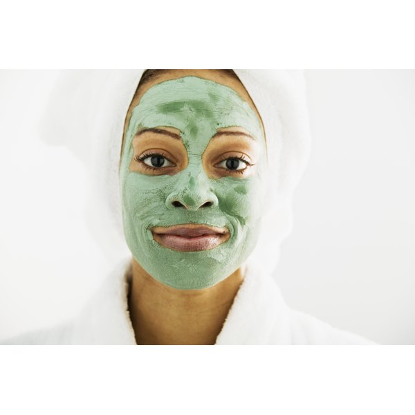 A woman has a facial mask on.