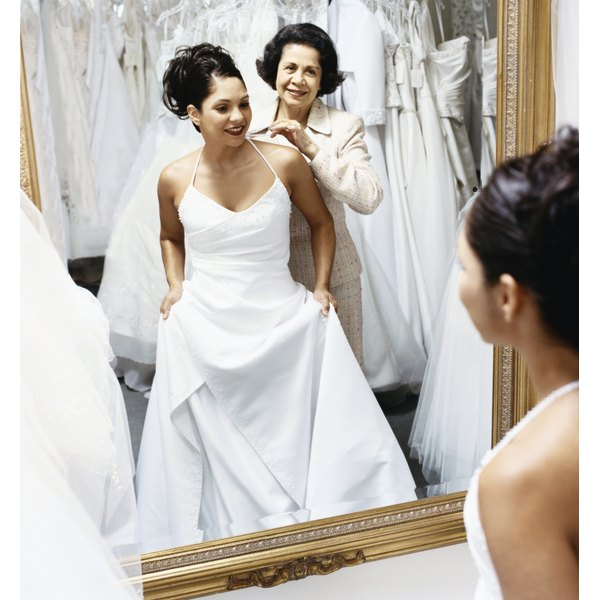 A godmother can assist the bride in dressing for the ceremony.