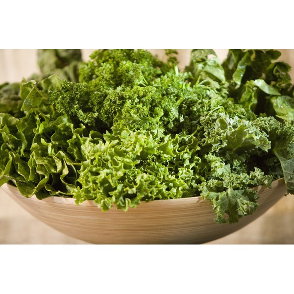Wooden bowl of greens and kale.