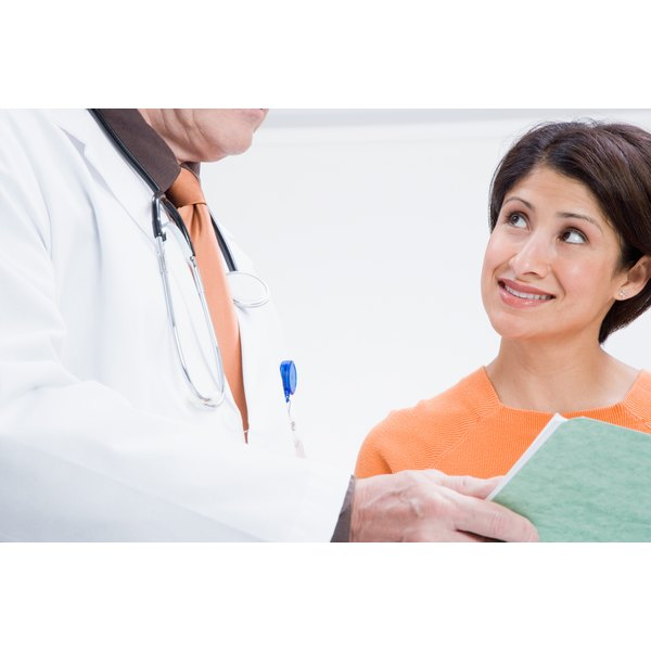 Doctor reading a patient's file