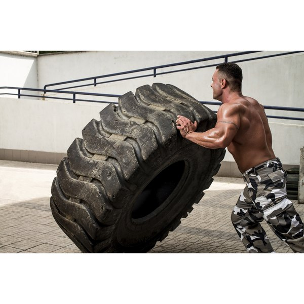 Body builder working out with tires.