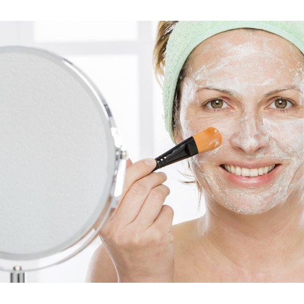 A premenopausal woman treats her acne with a facemask.