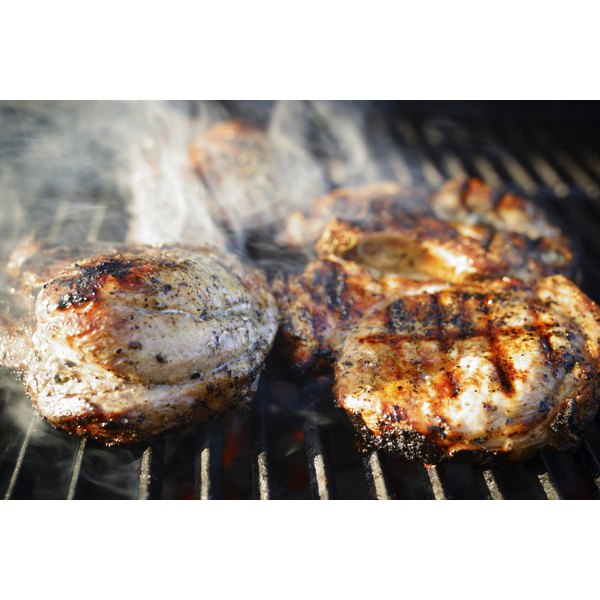 Pork loins on a grill.