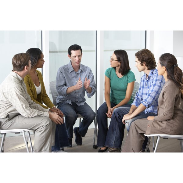 A group of people in a support group meeting.