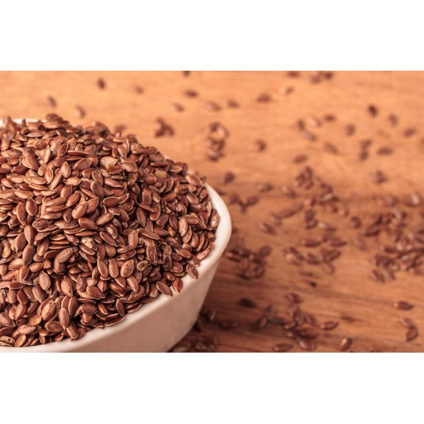 A bowl of flaxseeds on a table.