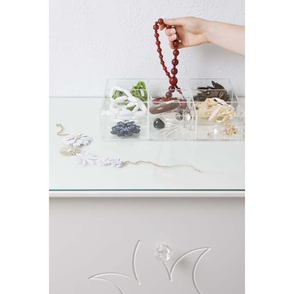Reorganize your jewelry box separating your pendants, amulets and medallions.