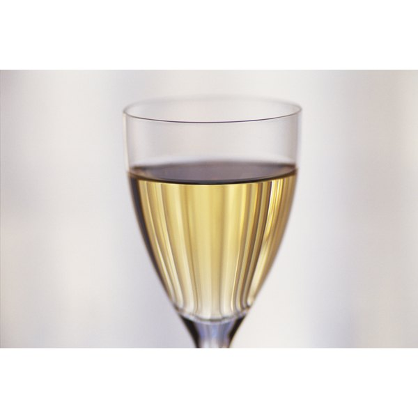A close-up of white wine in a glass.
