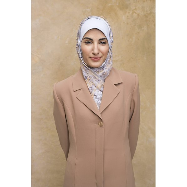 Head coverings are common for women at Muslim funerals.