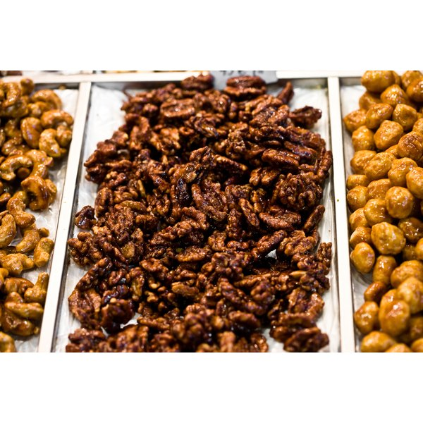A simple culinary technique makes seasonings adhere to roasted nuts.