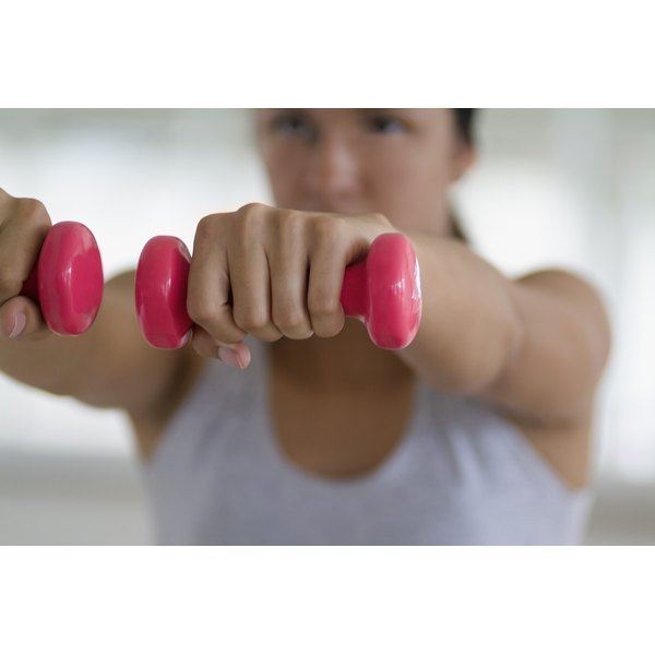 Young woman working out with hand weights.