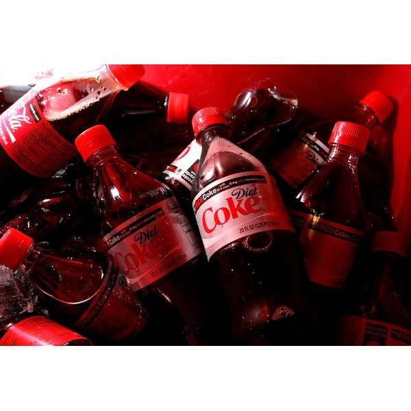 Close-up of a cooler of Coke and Diet Coke bottles.