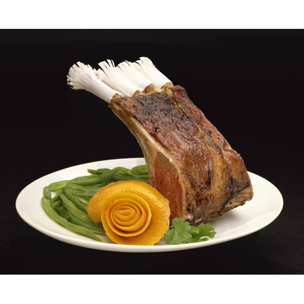 A rack of lamb often comes decorated with paper frills.