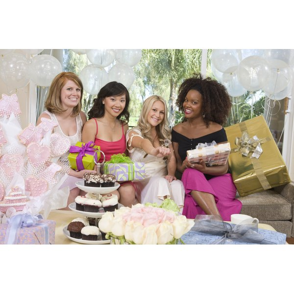 bride to be and friends with food and presents at a bridal shower