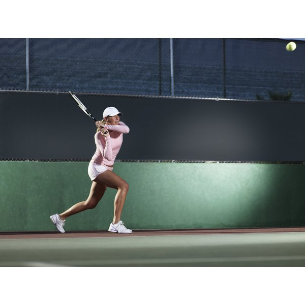Female tennis player hitting a backhand