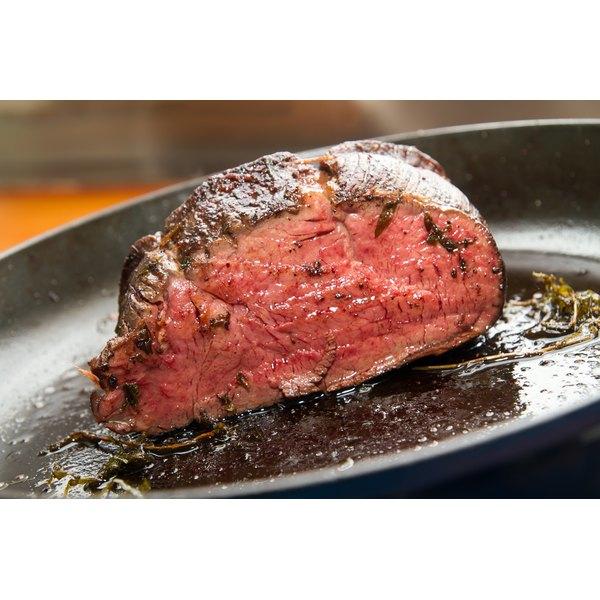 A juicy beef tenderloin, roasted and sliced in half.