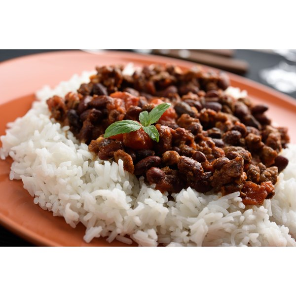 A plate of rice and beans served for a meal.