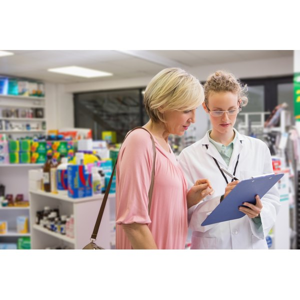 Pharmacist going over prescription with her patient