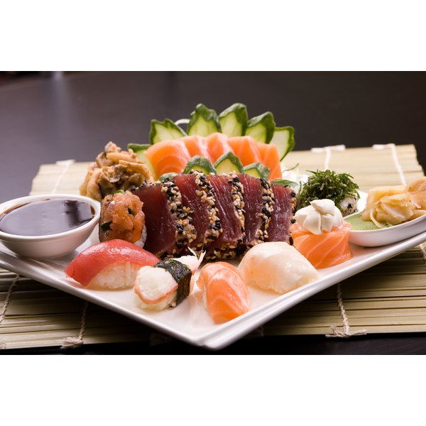 A variety of sushi and sashimi made with tuna.
