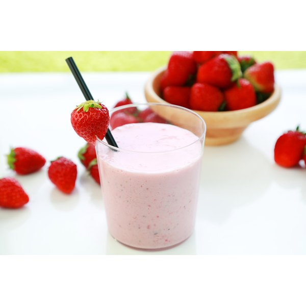 A smoothie made with yogurt and strawberries.