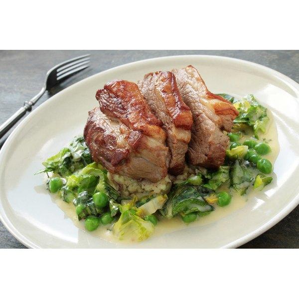 A pork roast on a plate.