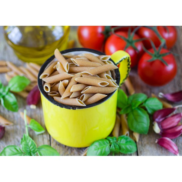 A cup filled with whole grain pasta.