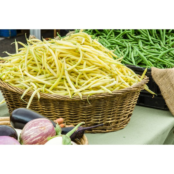 Basket of yellow snap beans shown at farmer's market.