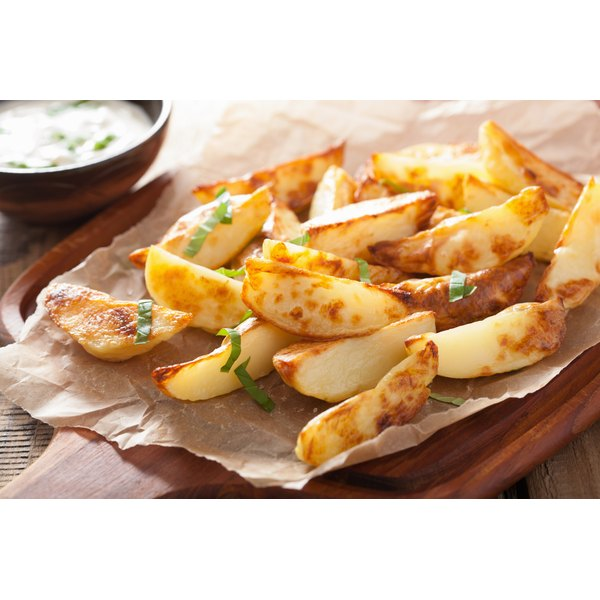 Homemade french fry wedges on a table.