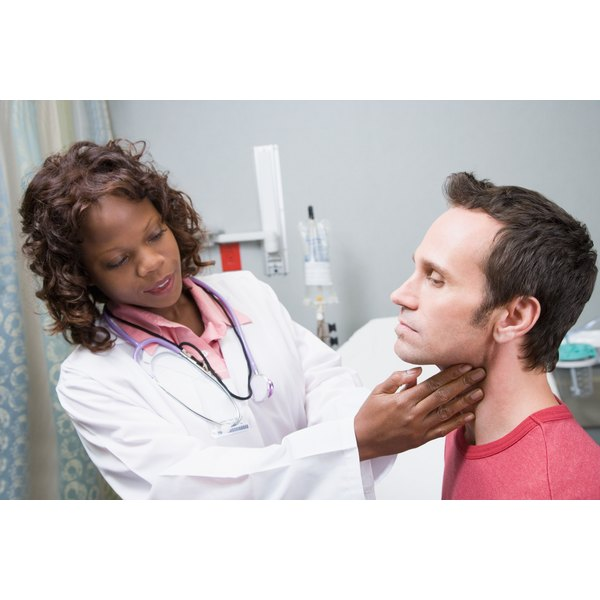 doctor feeling man's throat