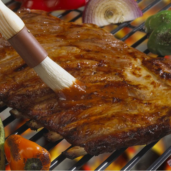 Baste the meat with homemade barbecue sauce repeatedly throughout slow cooking to maximize tenderness.
