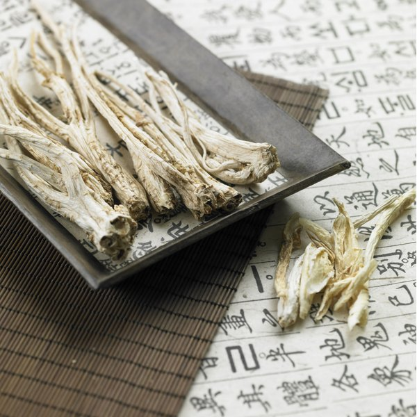 A plate of dried ginseng on a table.