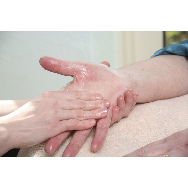 A therapist massaging a patient's hand.
