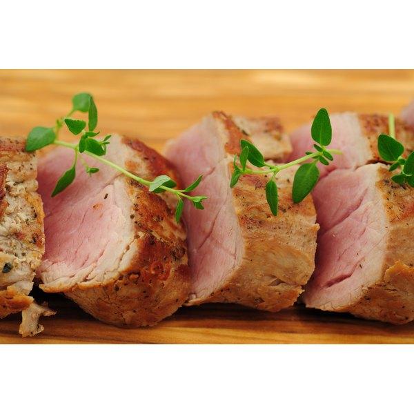 Beef tenderloin on a cutting board.