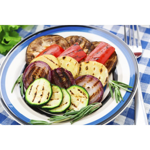 A plate of grilled vegetables and zucchini.