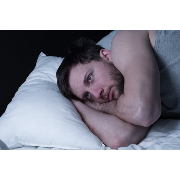 Man in bed with insomnia