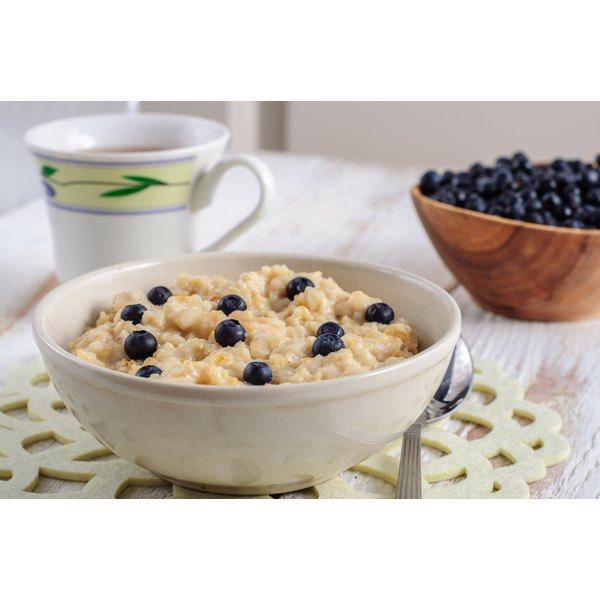A bowl of oatmeal with blueberries.