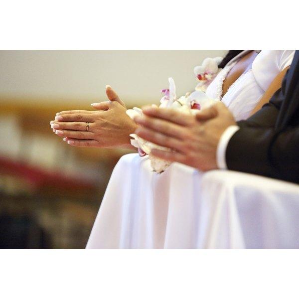 Newlyweds praying during wedding.