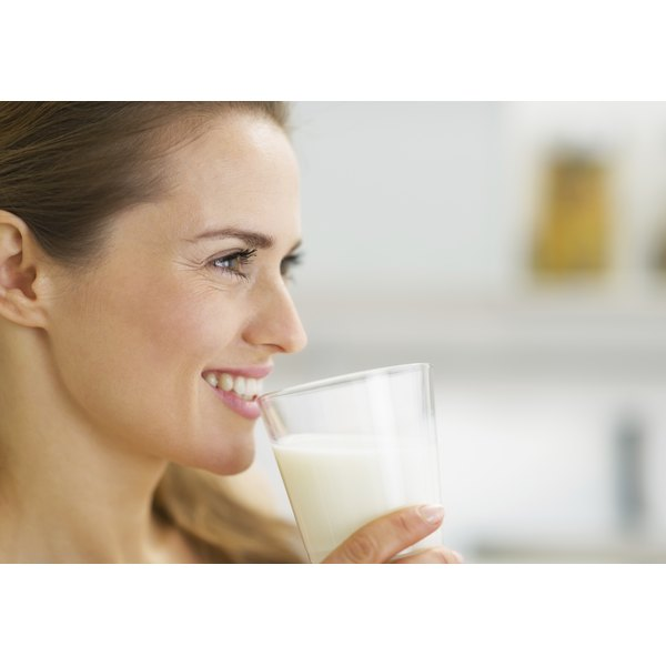 A woman about to drink some milk.