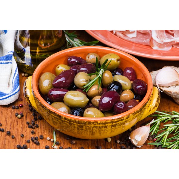 Bowl of mixed olives with rosemary