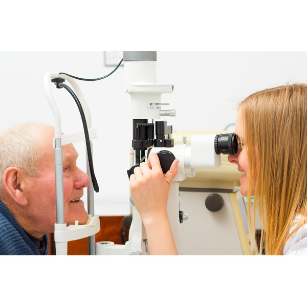 An eye doctor examining a patient's eye.