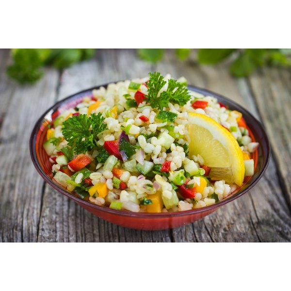 A tabouleh salad with vegetables and parsley.