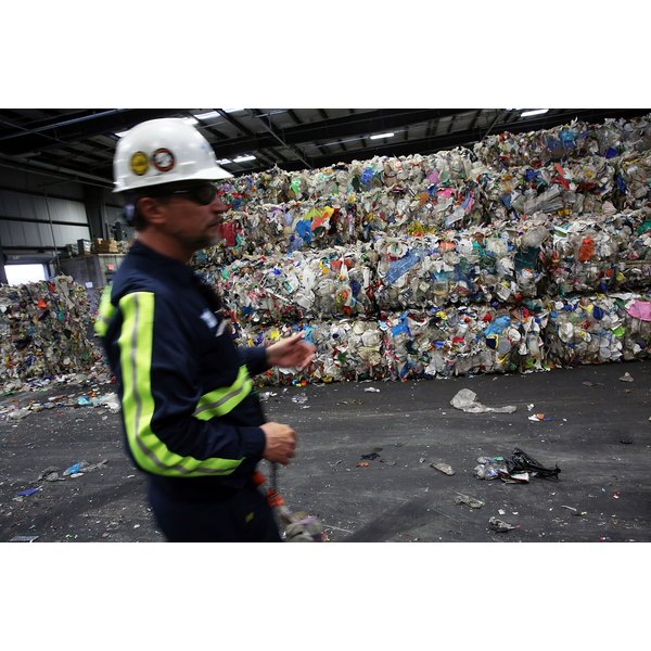 Tons of recyclable materials prepared for reuse at a facility.