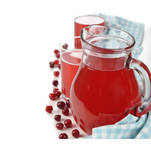 Cranberry juice on a white table.